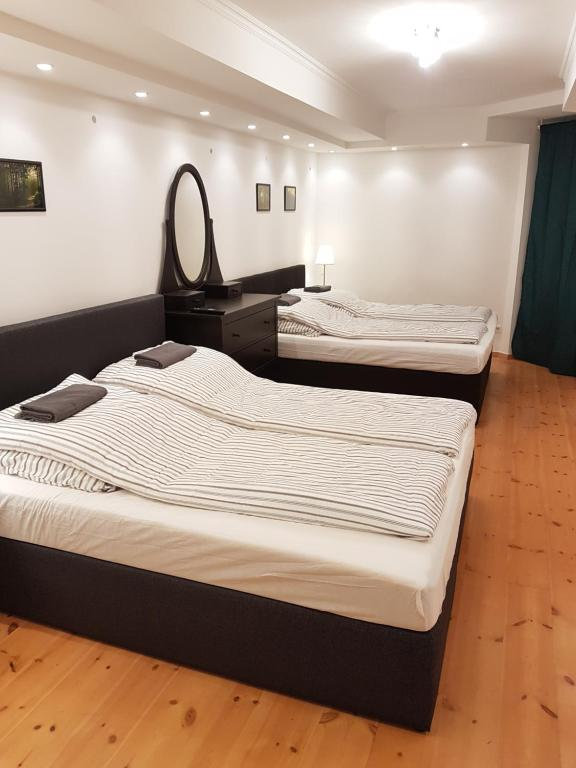 A bed or beds in a room at Central Apartment near Potsdamer Platz