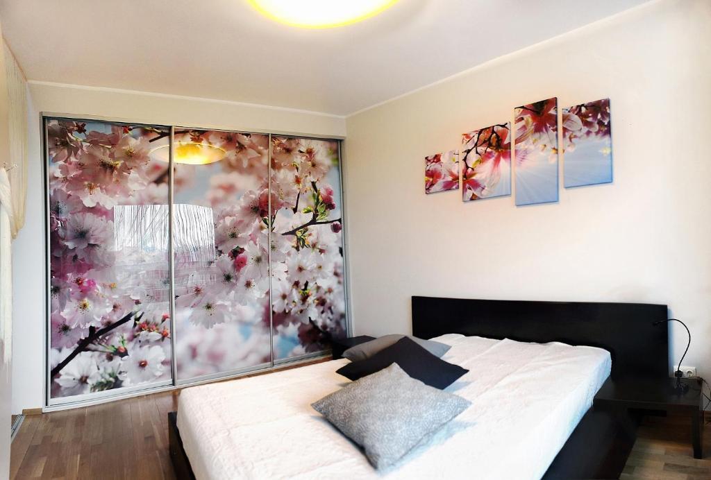 Gulta vai gultas numurā naktsmītnē Sakura Apartments