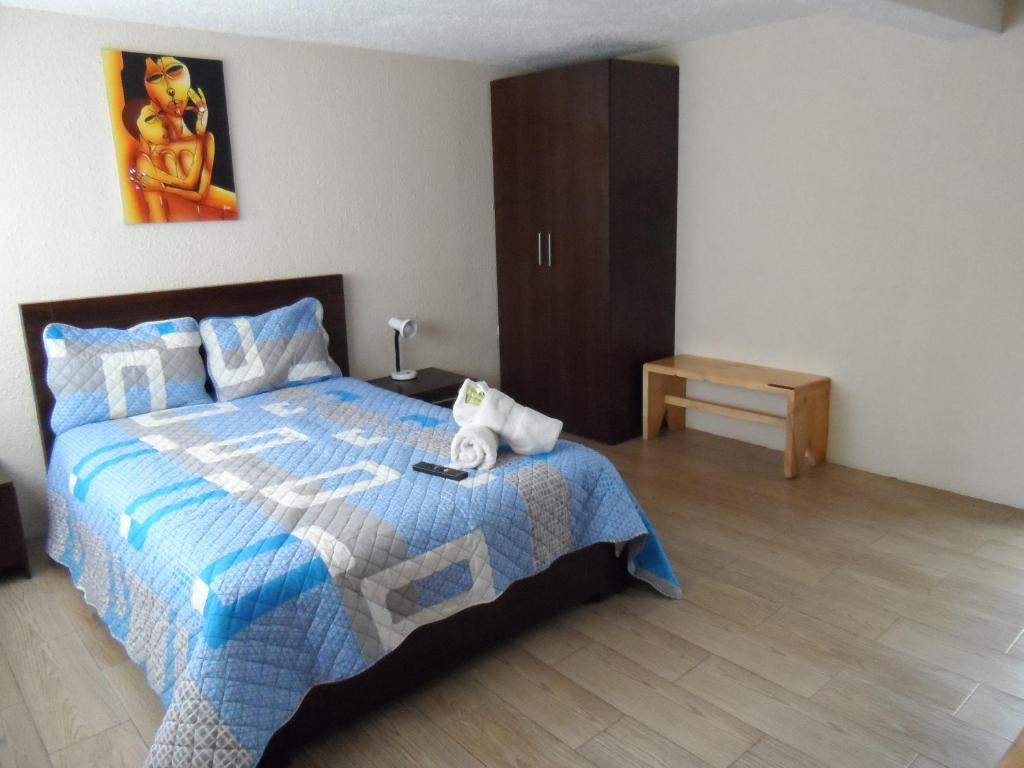 A bed or beds in a room at Hostal Monte Carmelo