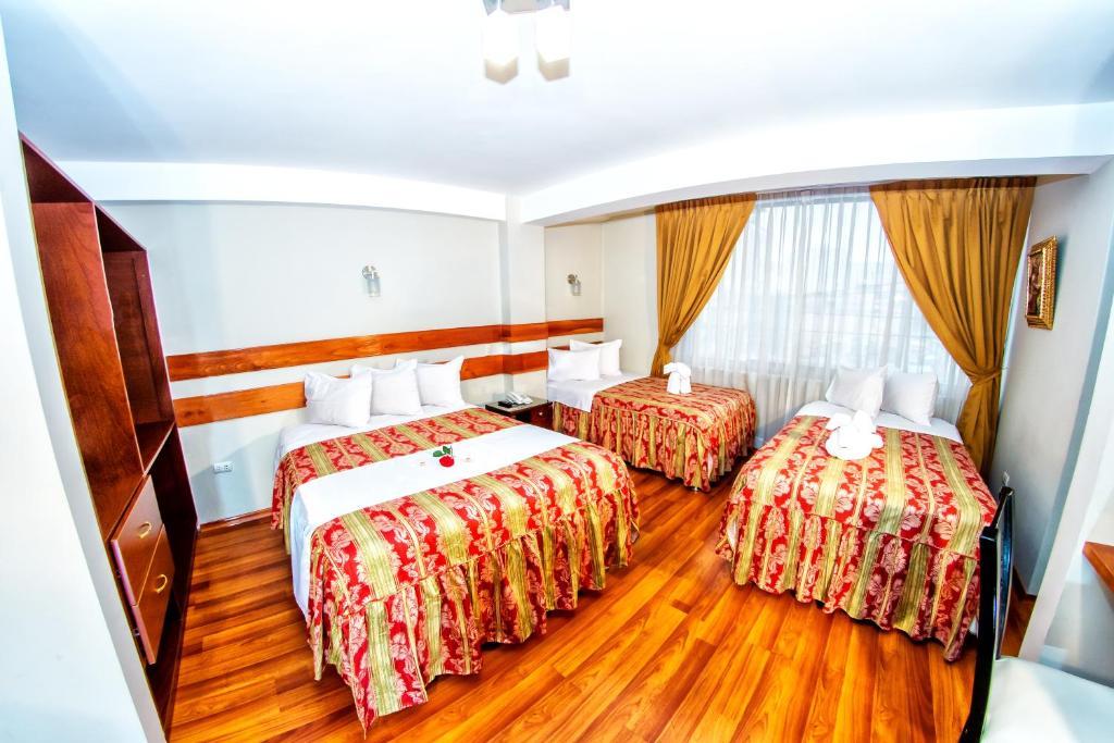Hostal Los Andes tesisinde bir odada yatak veya yataklar