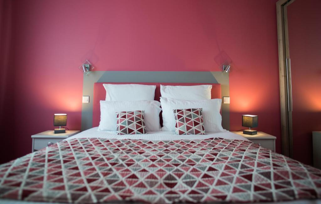 Un ou plusieurs lits dans un hébergement de l'établissement Les Chambres Du Gres