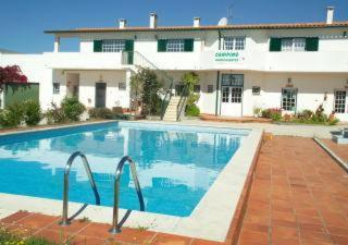 The swimming pool at or near Camping / Appartment Coimbrao