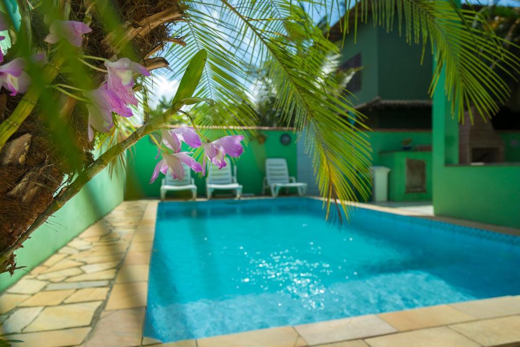 The swimming pool at or near Pousada Camila