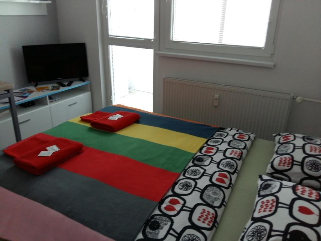 A bed or beds in a room at Apartment Sportovy