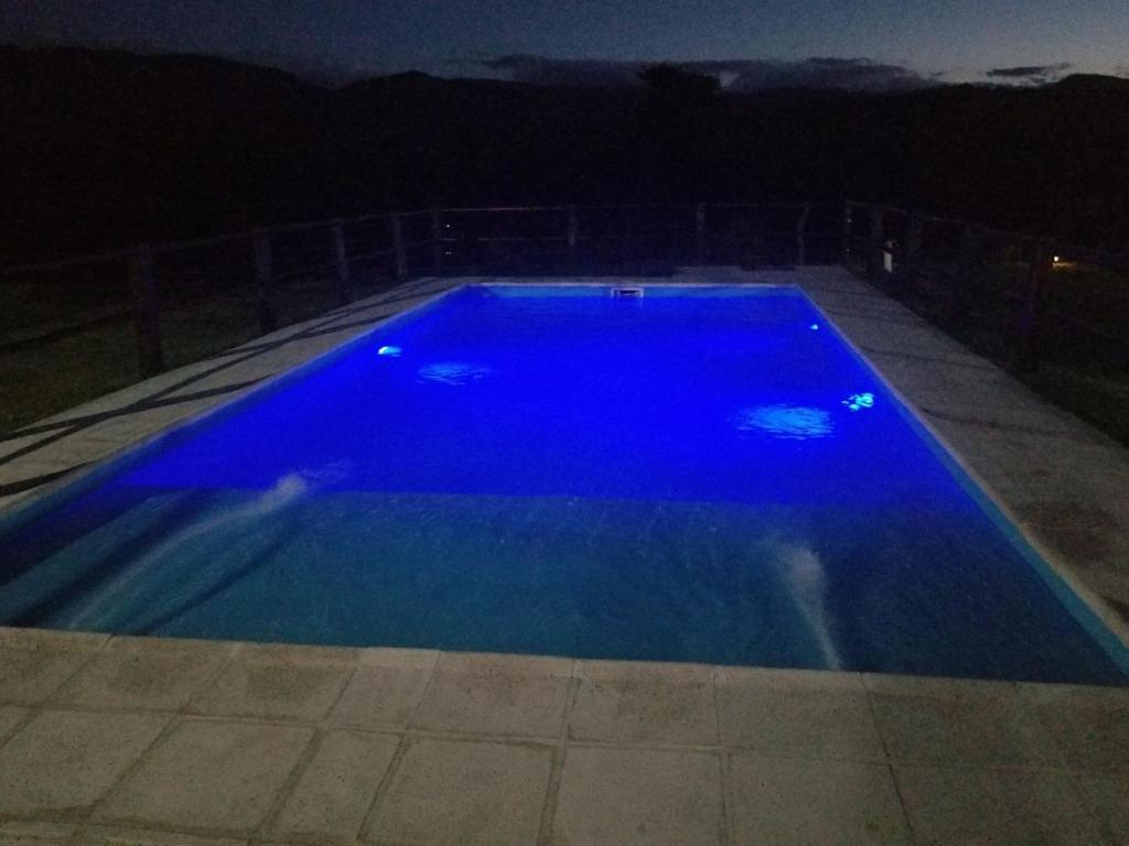 The swimming pool at or near Cabañas Valle Del Chutuzno