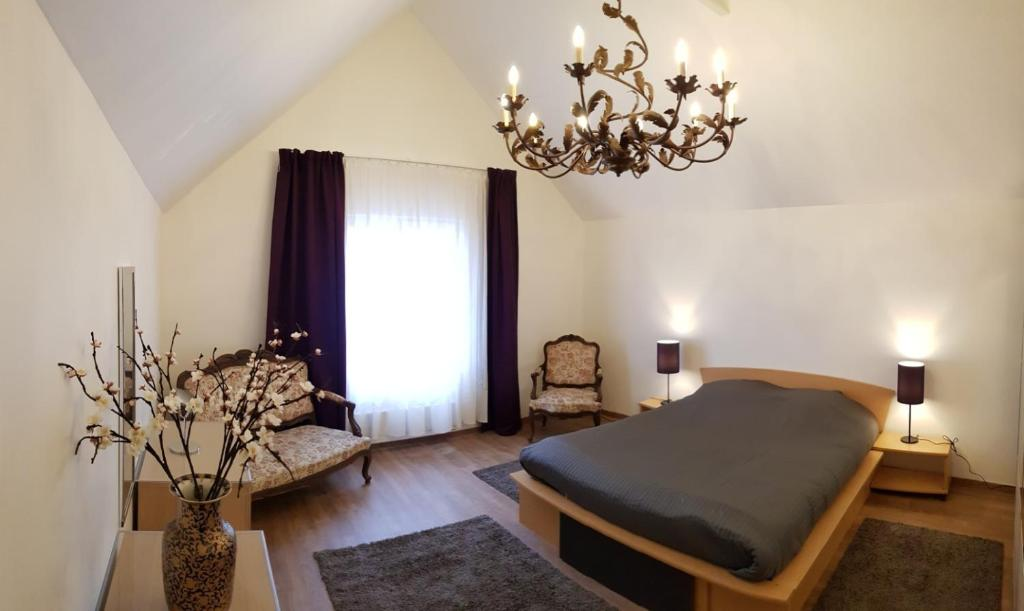 Un ou plusieurs lits dans un hébergement de l'établissement La Maison du Petit Lavoir