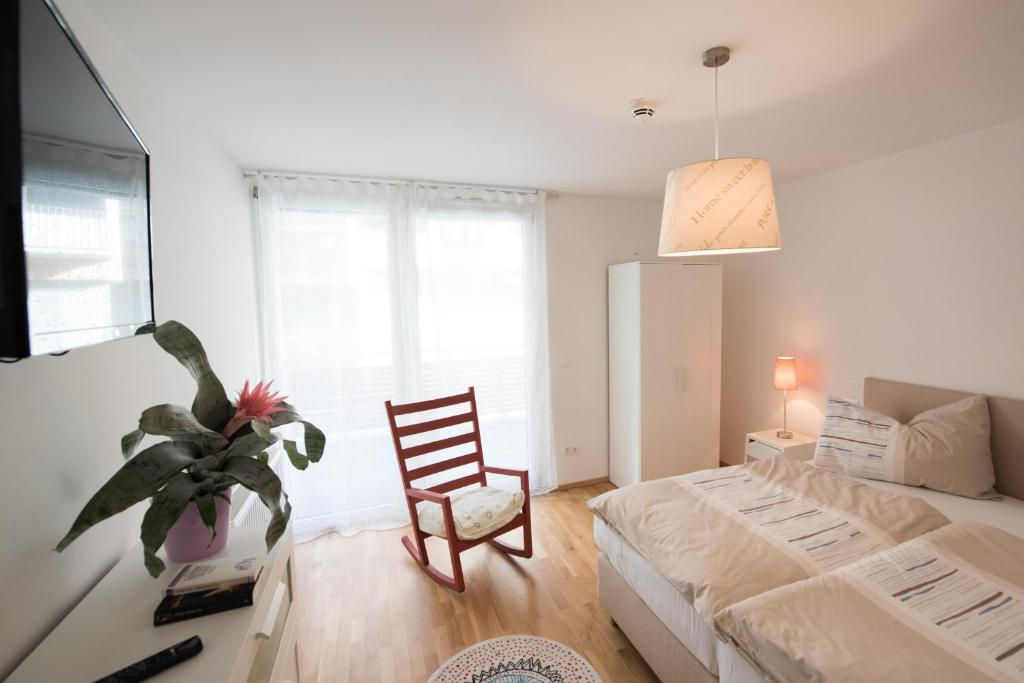 A bed or beds in a room at FeelGood Apartments Seestadt Vienna