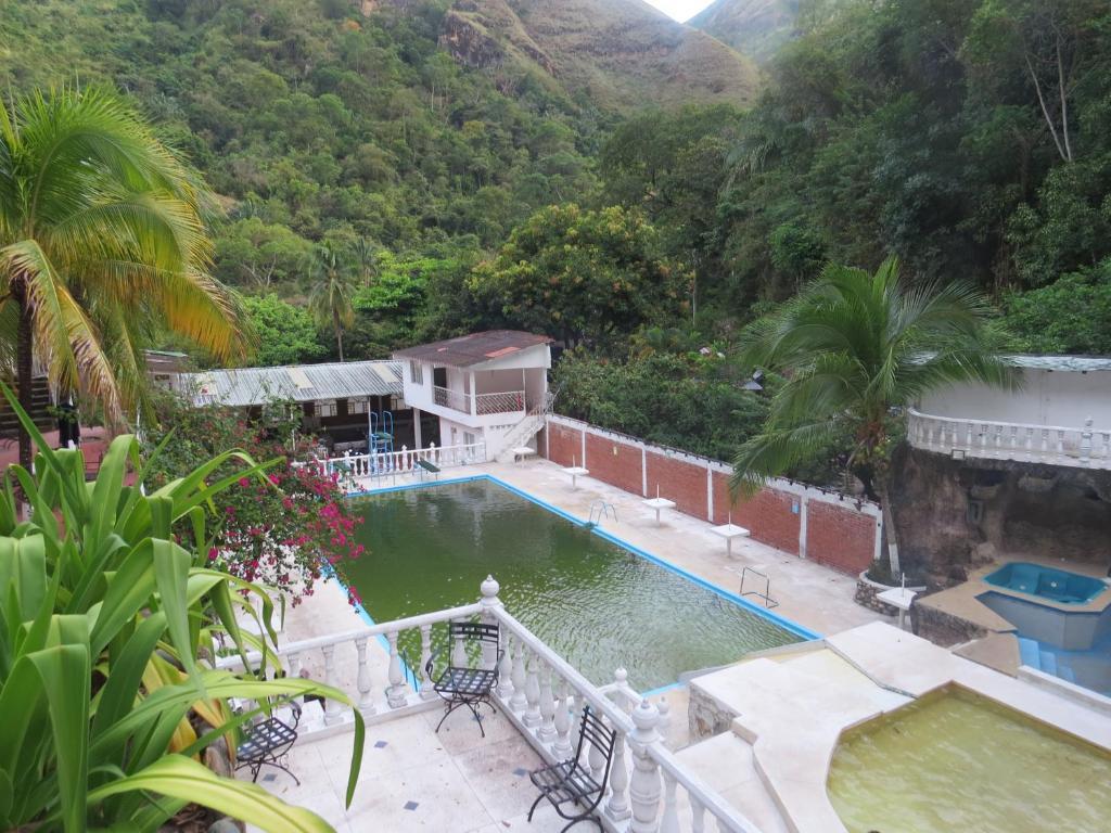 Piscina natural cascada melgar precios actualizados 2018 for Cerramiento para piscinas colombia