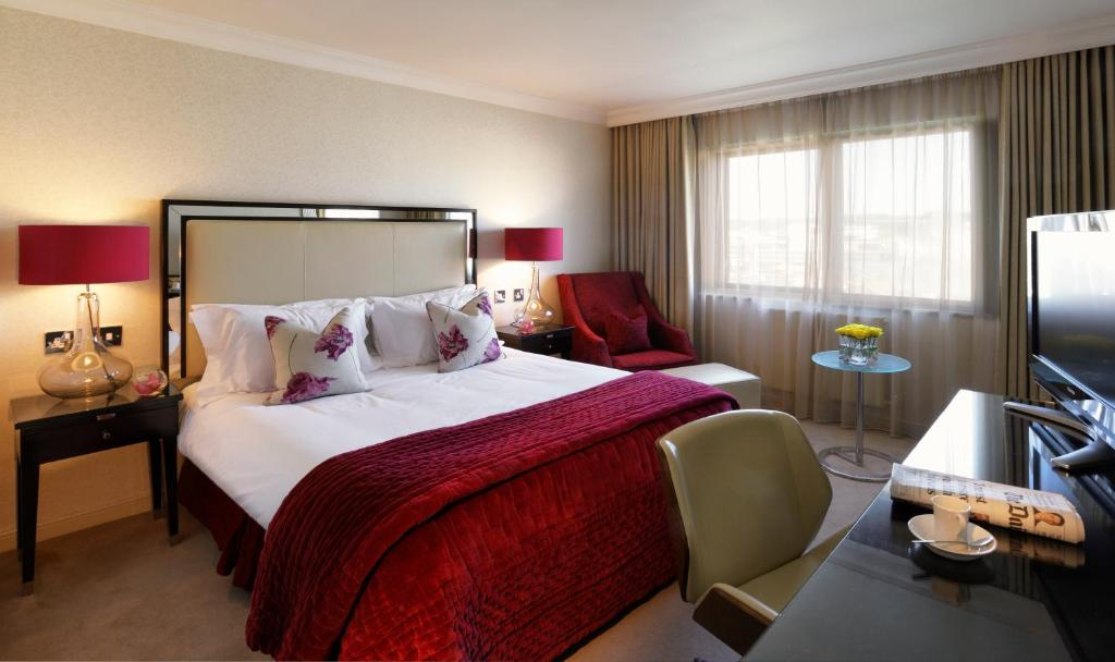 A bed or beds in a room at The Bristol Hotel