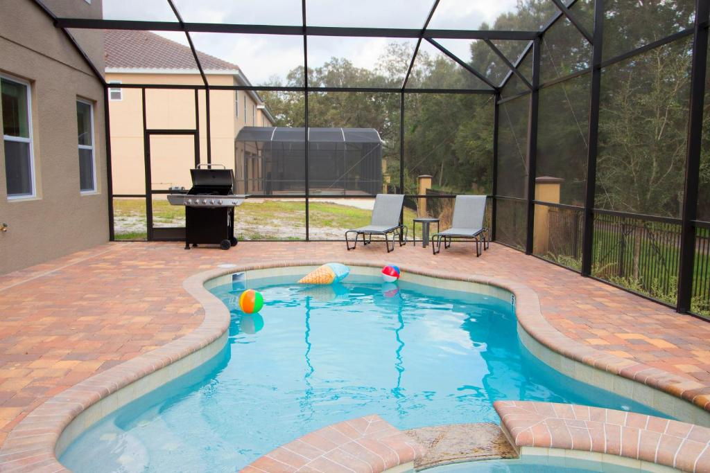 Vacation home aco premium seven bedrooms with pool spa and grill 1762 kissimmee fl for 7 bedroom vacation homes in kissimmee fl