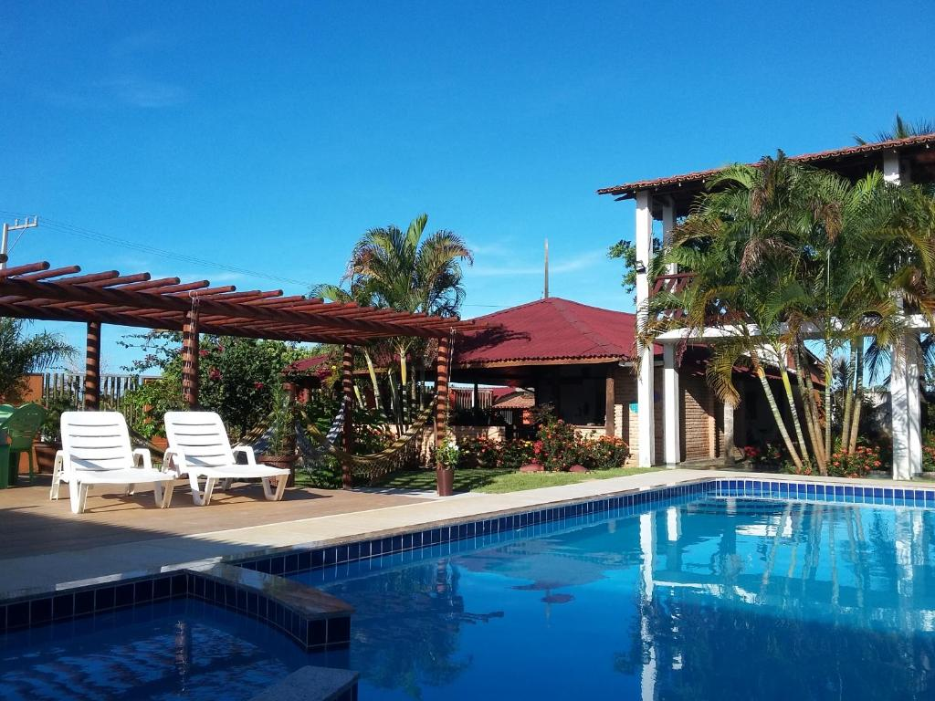 The swimming pool at or near Pousada Coral de Fogo