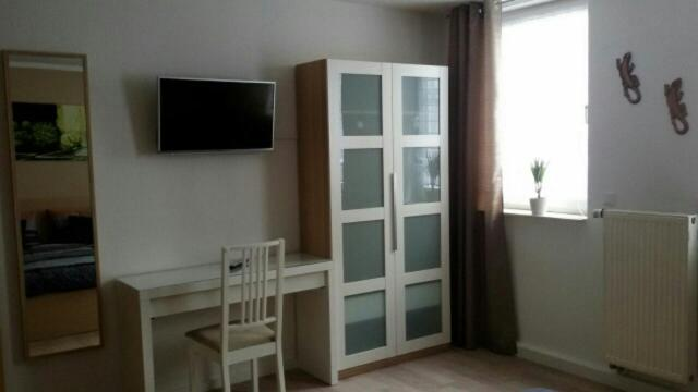 A television and/or entertainment center at Lina´s Ferienwohnung