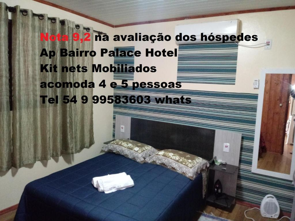 Letto o letti in una camera di AP Bairro Palace Hotel