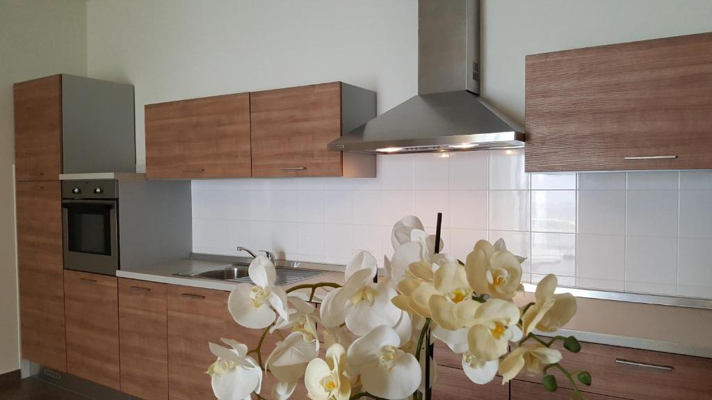 A kitchen or kitchenette at Riviera Palace Residence