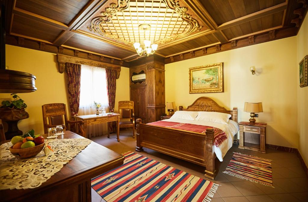 A bed or beds in a room at Brilant Antik Hotel