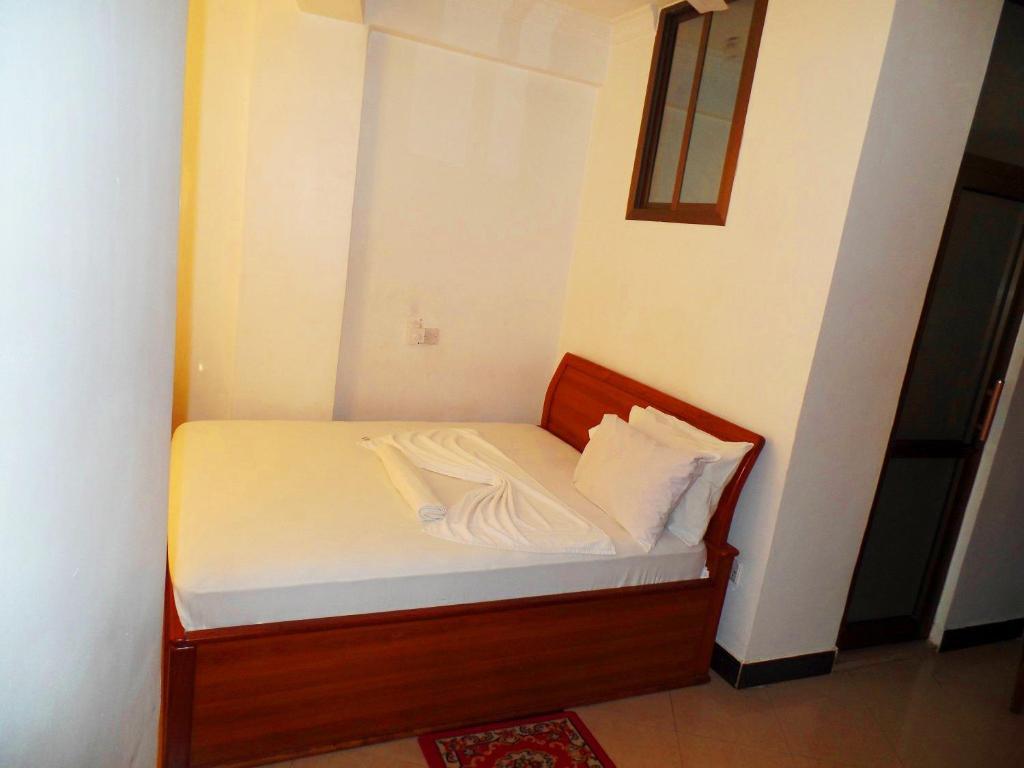 Łóżko lub łóżka w pokoju w obiekcie Conway Hotel