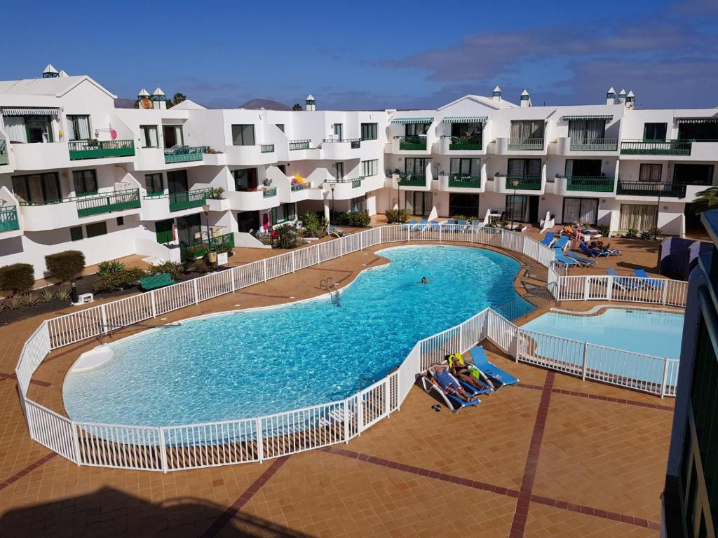 A view of the pool at Playa de las Cucharas Apartments or nearby
