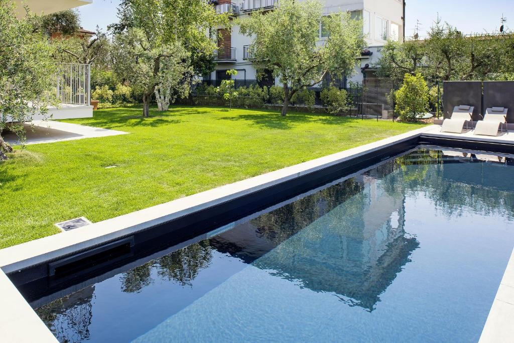 The swimming pool at or near Bardolino center ground floor with pool and garden