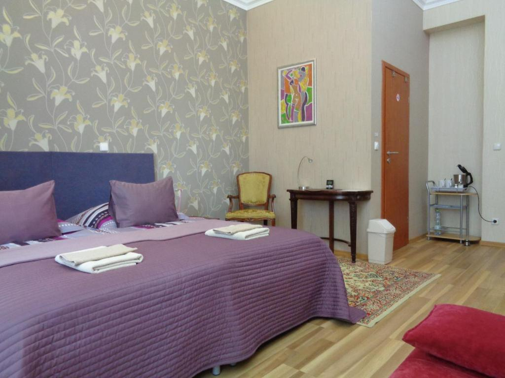 A bed or beds in a room at Budapest GuestRooms