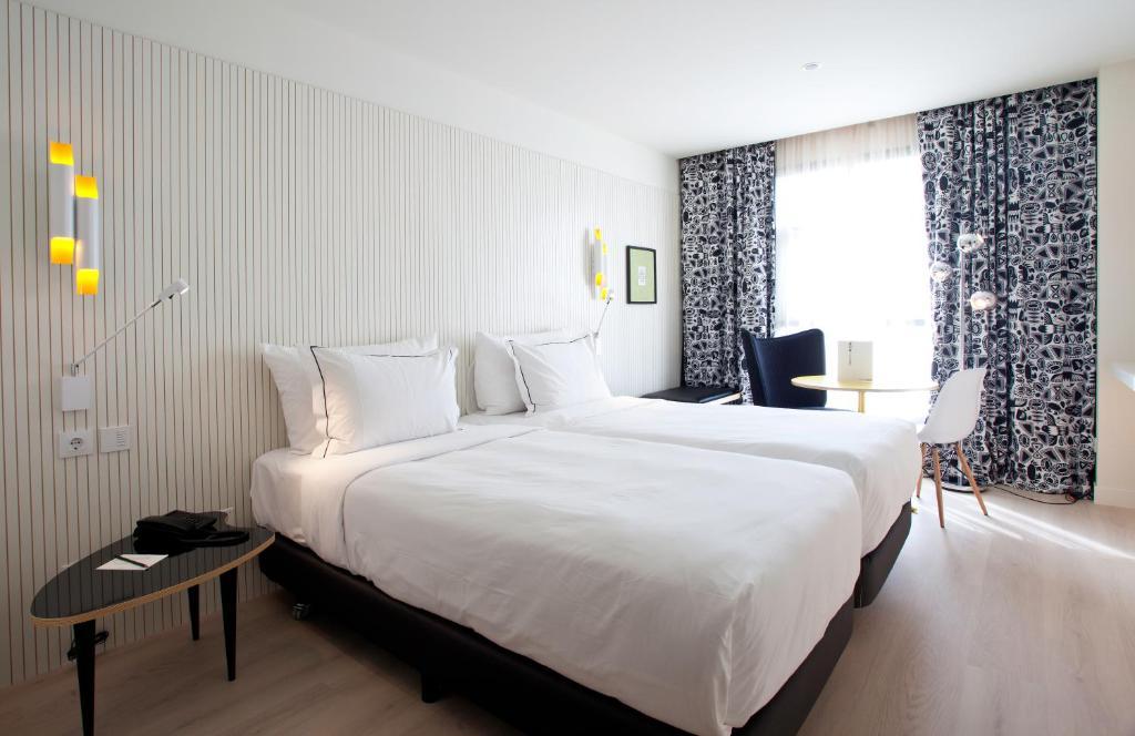 Cama o camas de una habitación en Vincci Bit