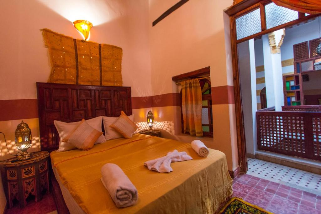 A bed or beds in a room at Riad La Presidence