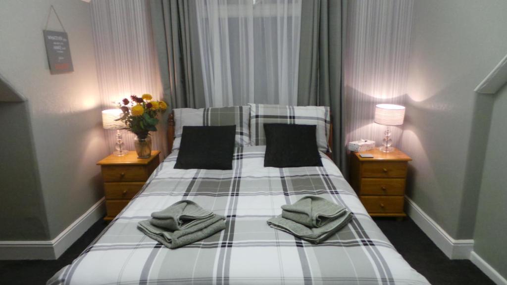 Ein Bett oder Betten in einem Zimmer der Unterkunft Oakcliffe Hotel
