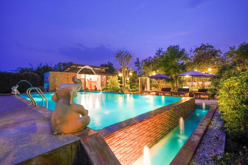The swimming pool at or near Vieng Tawan Sukhothai Guesthouse by Thai Thai