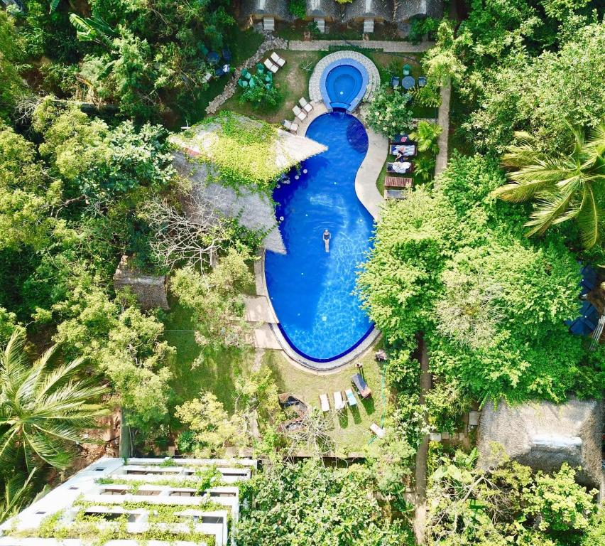 A view of the pool at Sundaras Resort & Spa or nearby