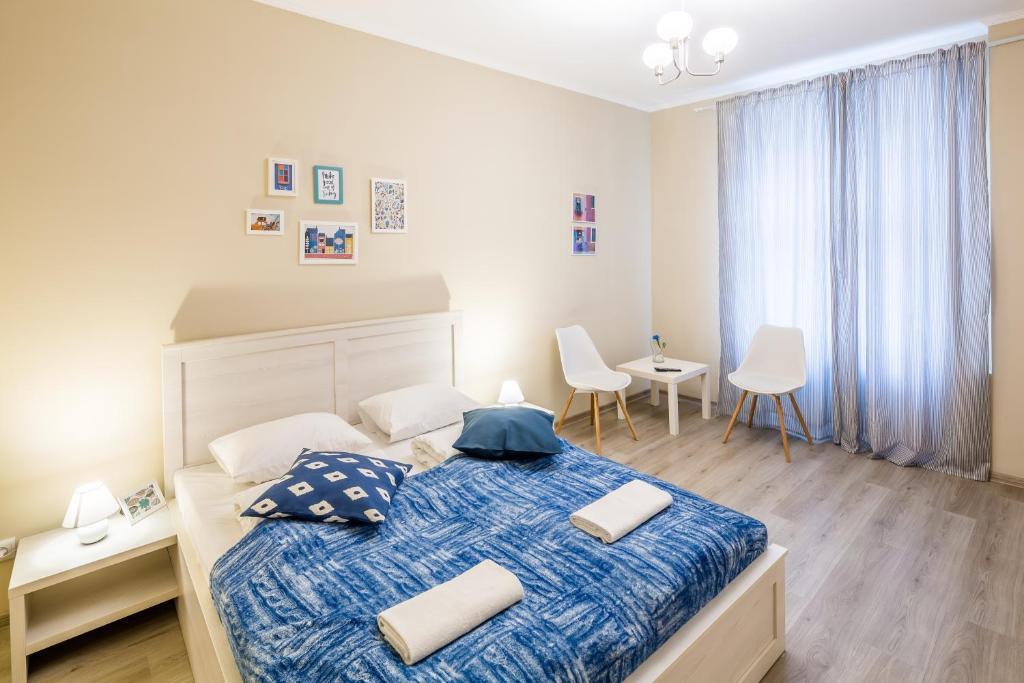 Ліжко або ліжка в номері Dominic Apartments