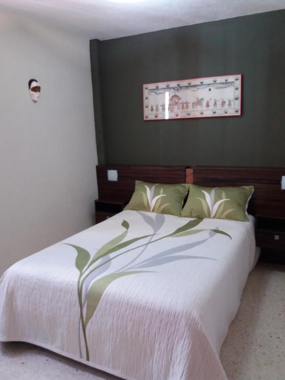 A bed or beds in a room at Apartamento Sin Fronteras