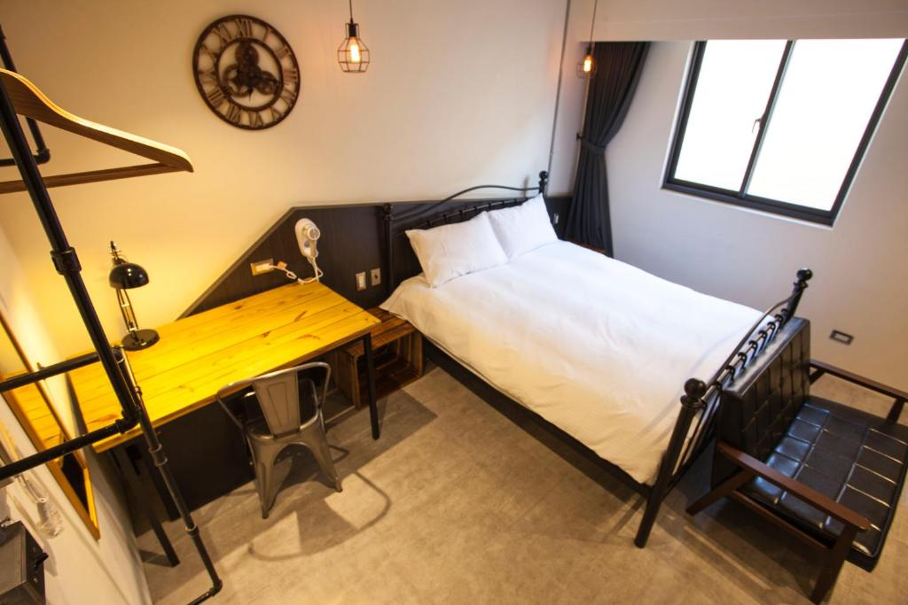 A bed or beds in a room at Loft Hostel Taichung