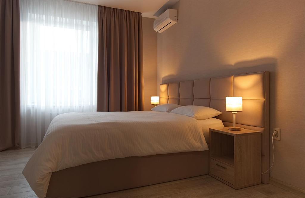 Кровать или кровати в номере Мини-отель «Манхэттен»
