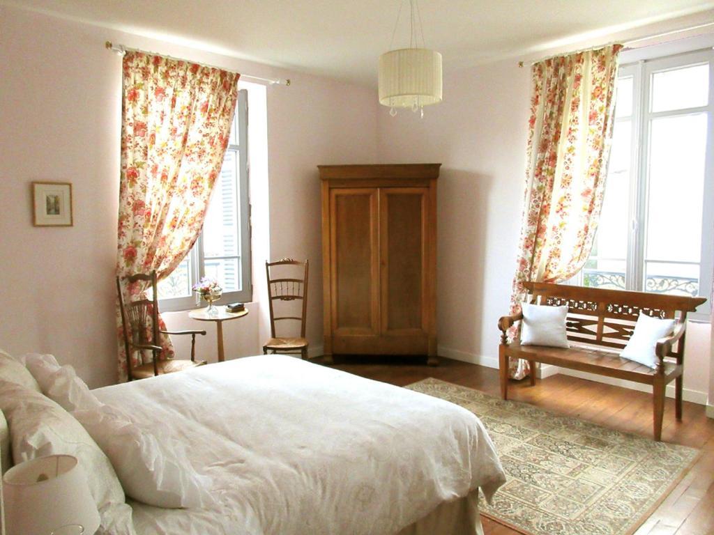 Un ou plusieurs lits dans un hébergement de l'établissement Chambres d'hôtes à Pau, proche centre