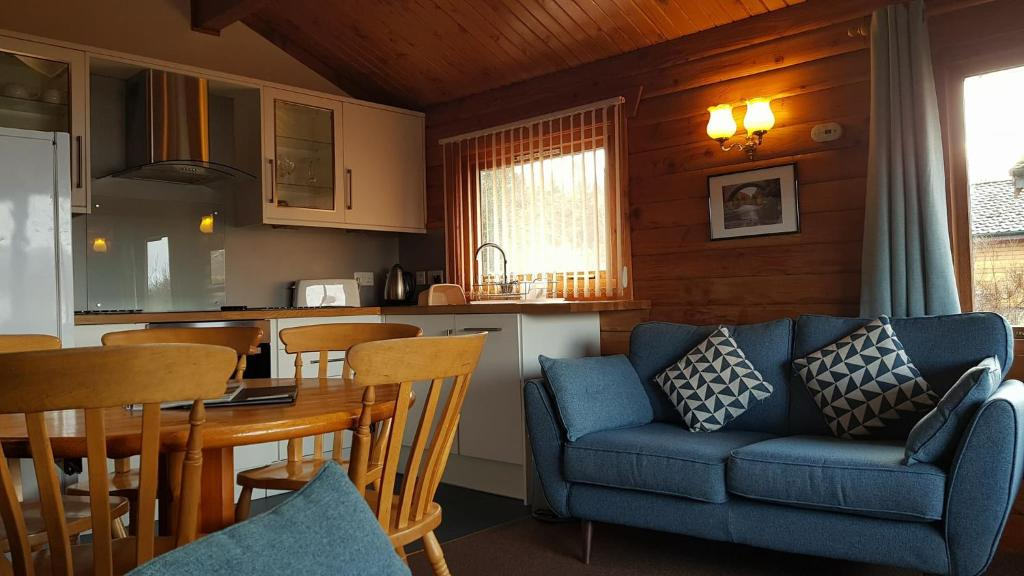 A seating area at Loch Insh Chalets Ltd