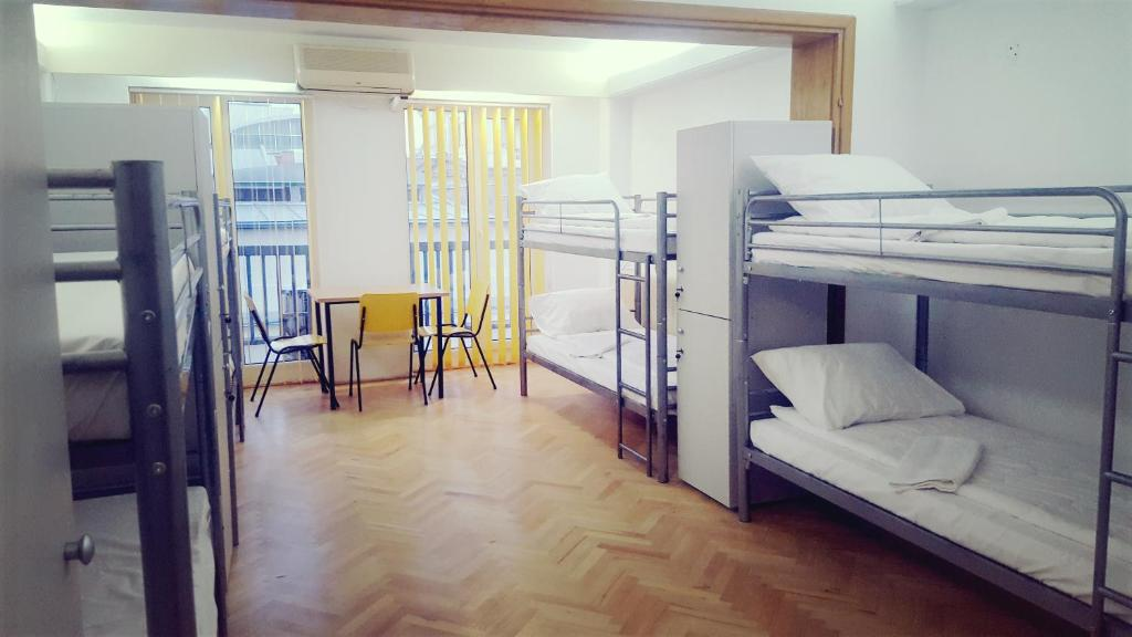 A bunk bed or bunk beds in a room at Sleep Inn Hostel