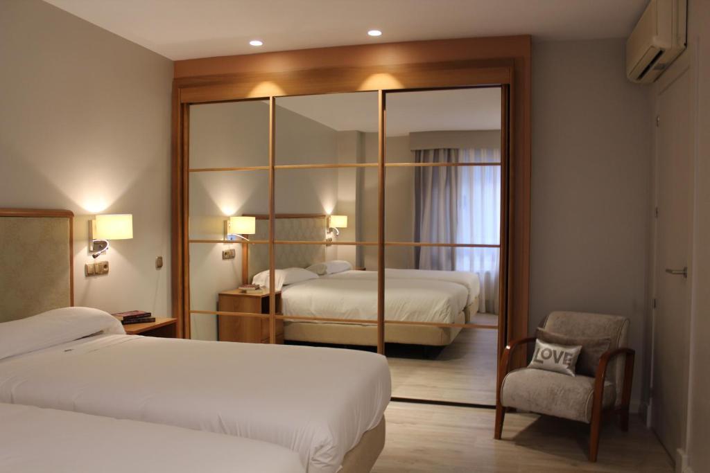Cama o camas de una habitación en Hotel Carreño