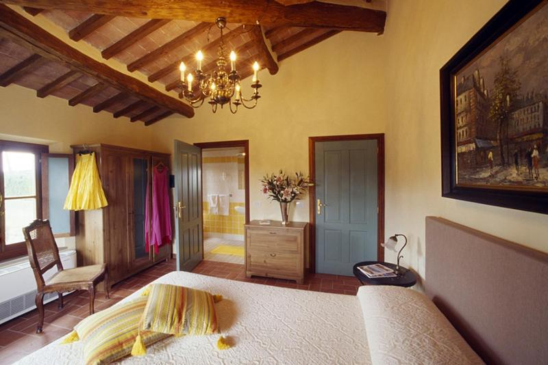 A bed or beds in a room at Agriturismo B&B Podere San Lorenzo
