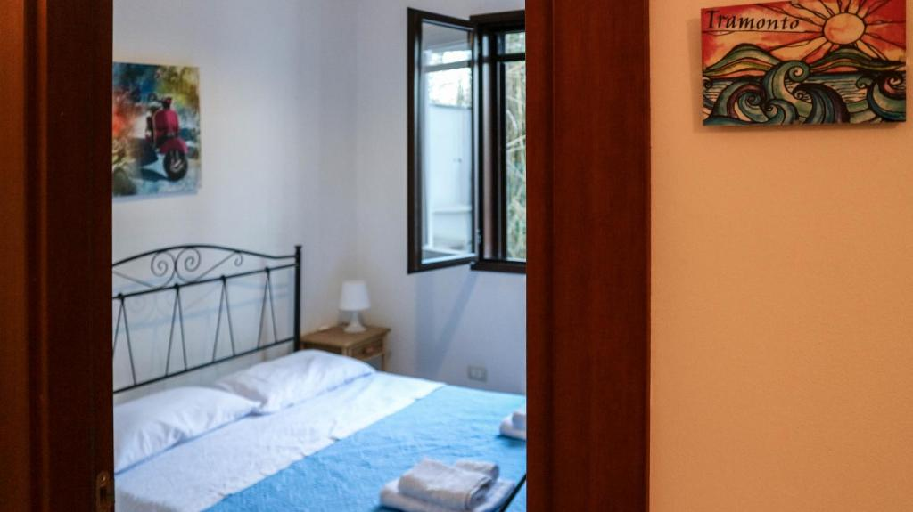 A bed or beds in a room at B&B La Spiaggia