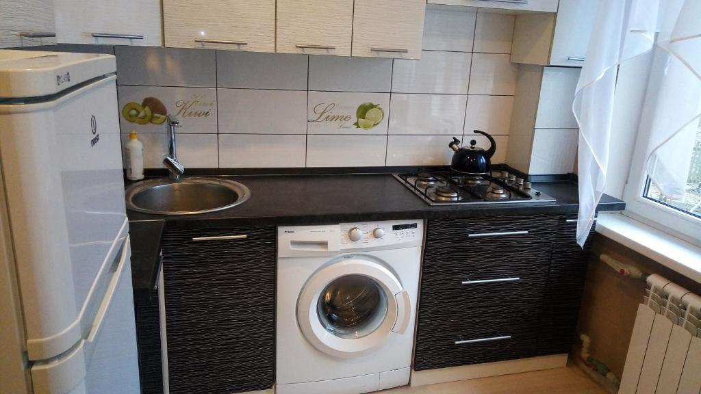 Кухня или мини-кухня в Pillau Apartments