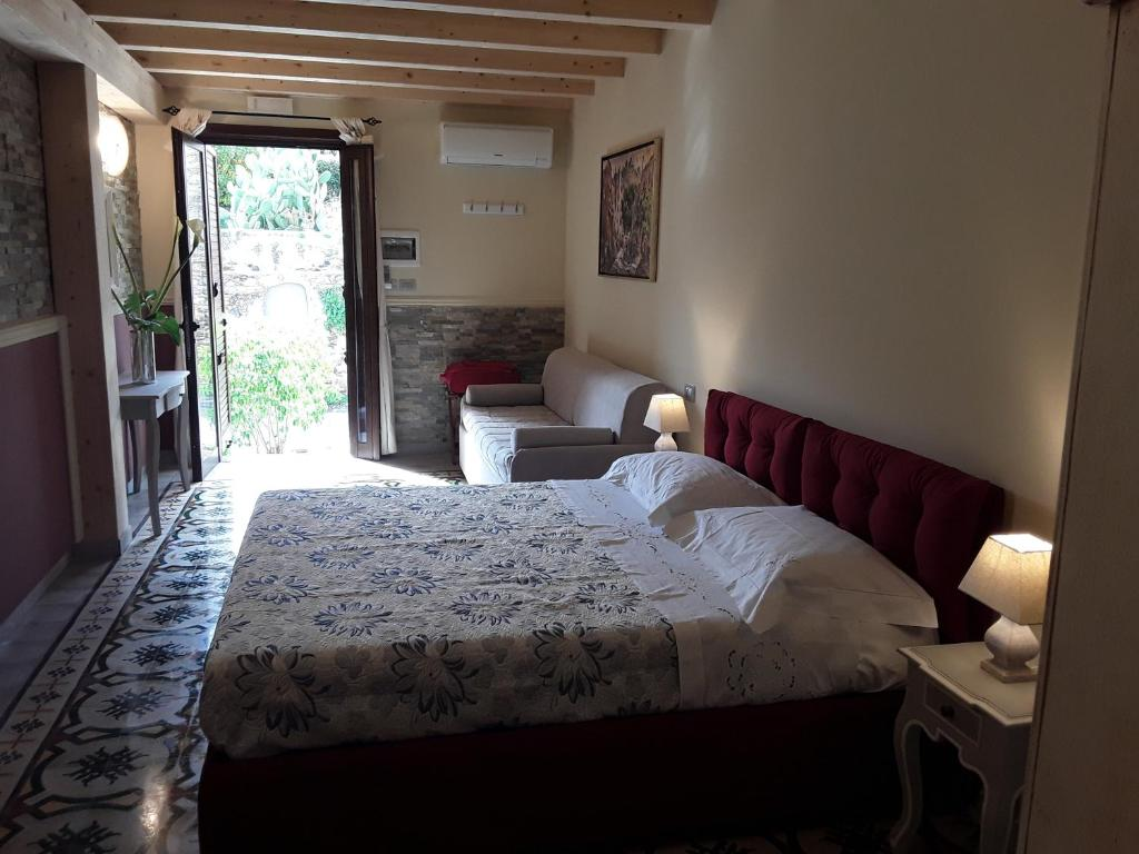 A bed or beds in a room at Al Castello