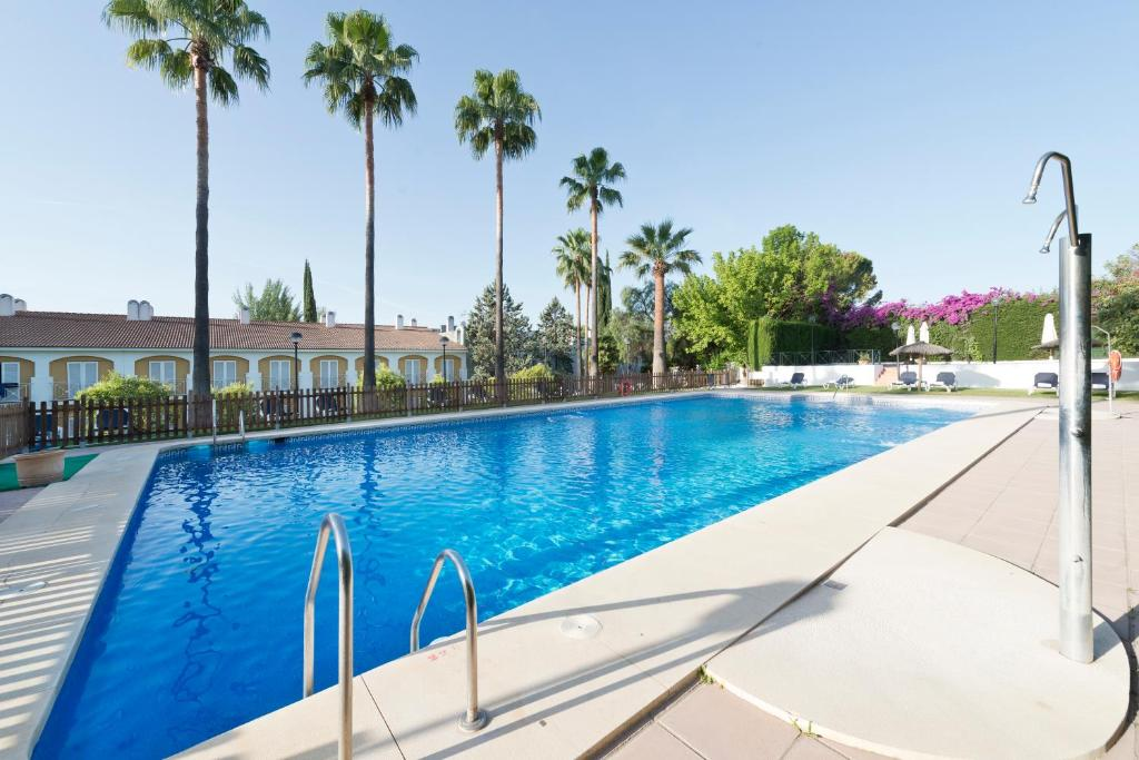 The swimming pool at or near Exe Las Adelfas