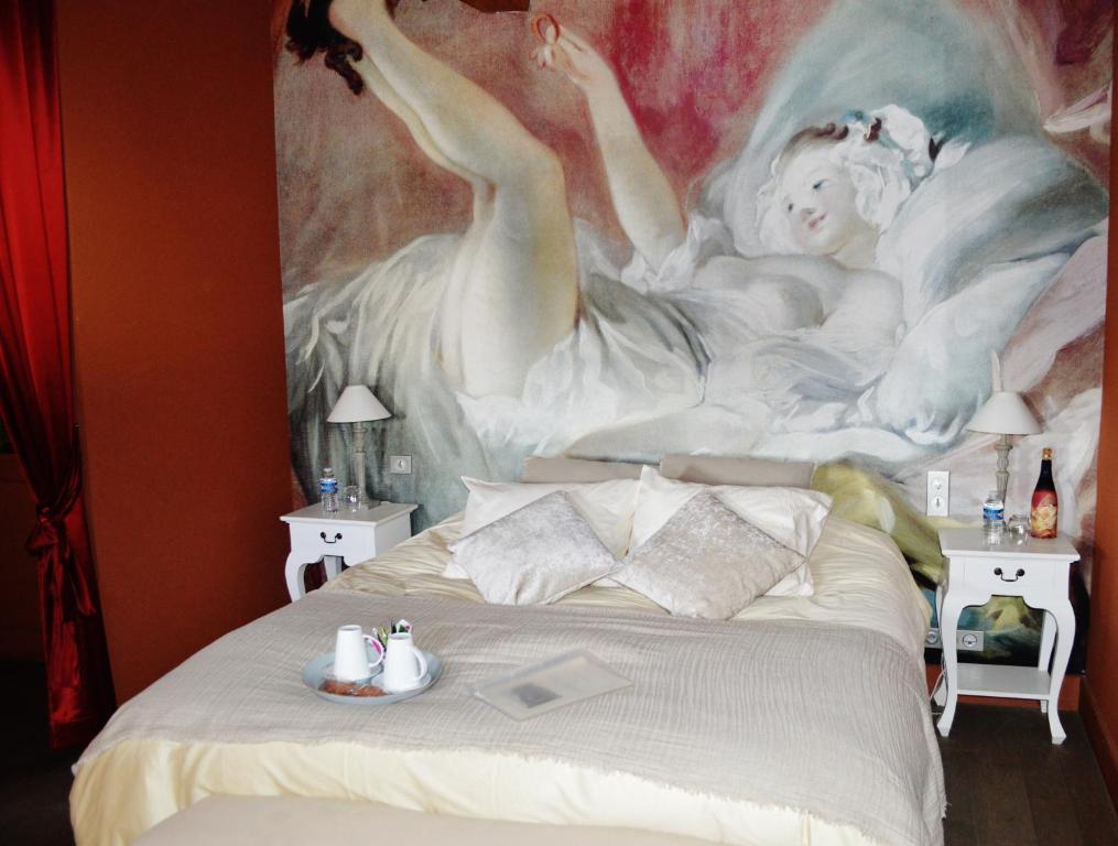Un ou plusieurs lits dans un hébergement de l'établissement Le Clos Margot