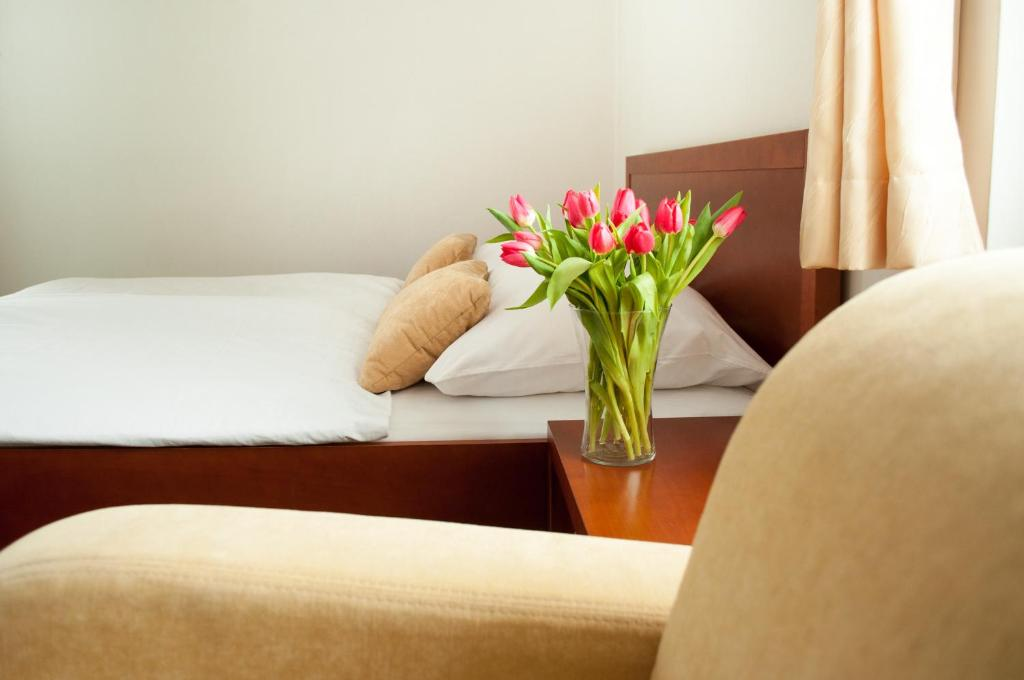 Postelja oz. postelje v sobi nastanitve B&B Vila Otočec