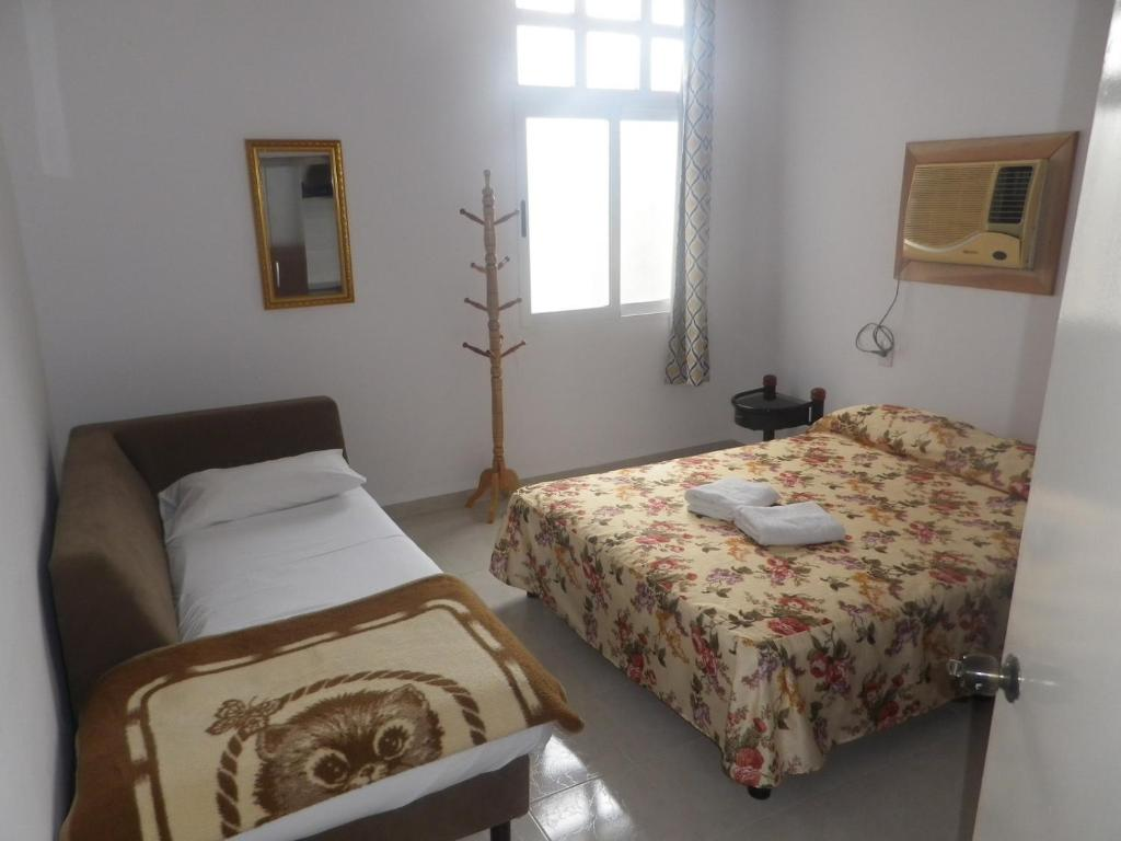 A bed or beds in a room at Apto Adriana e Iván