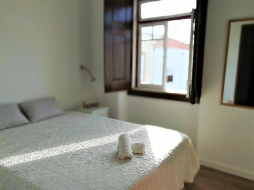 A bed or beds in a room at Casa da Vila