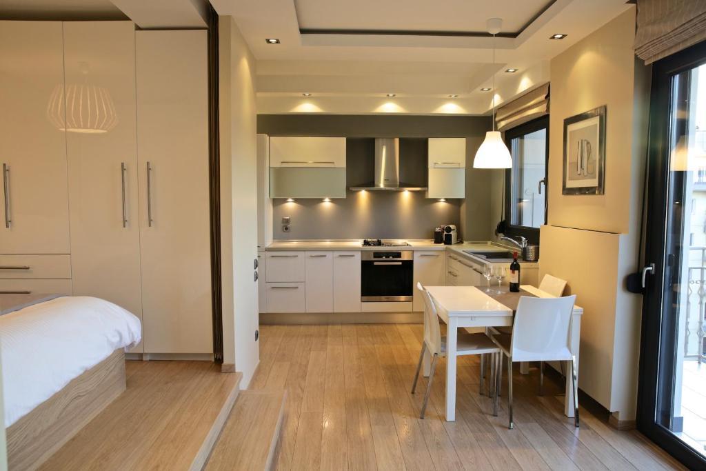 A kitchen or kitchenette at Navarinou Loft Apartment