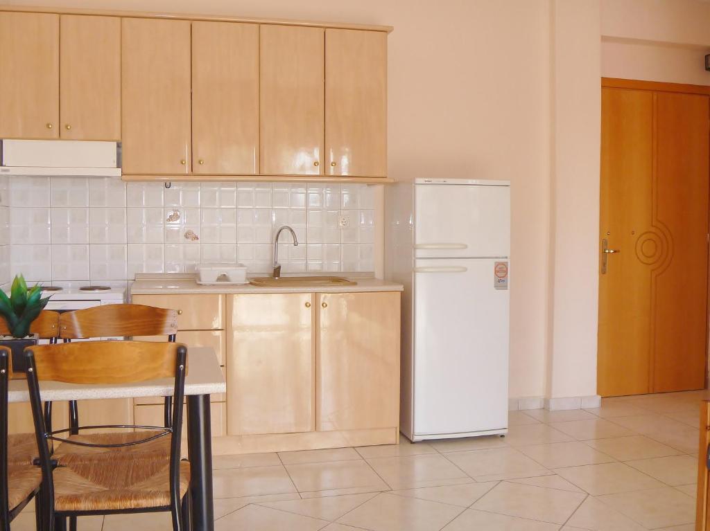 Een keuken of kitchenette bij Dionysos