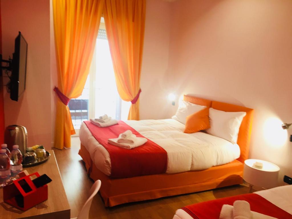 Posteľ alebo postele v izbe v ubytovaní B&B Grande Archivio Napoli