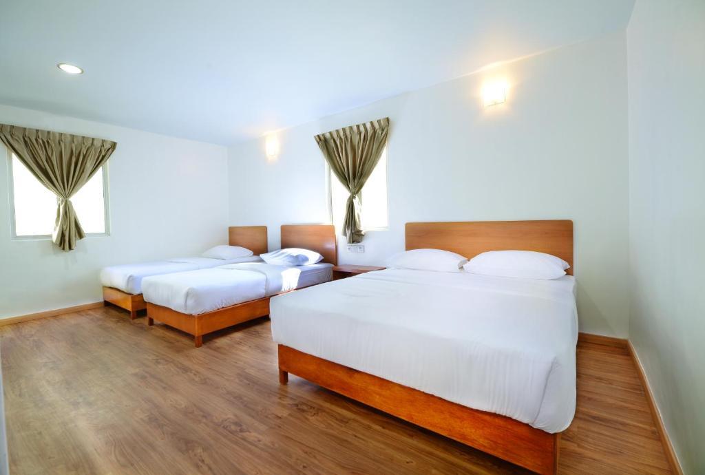 Кровать или кровати в номере MG Hotel