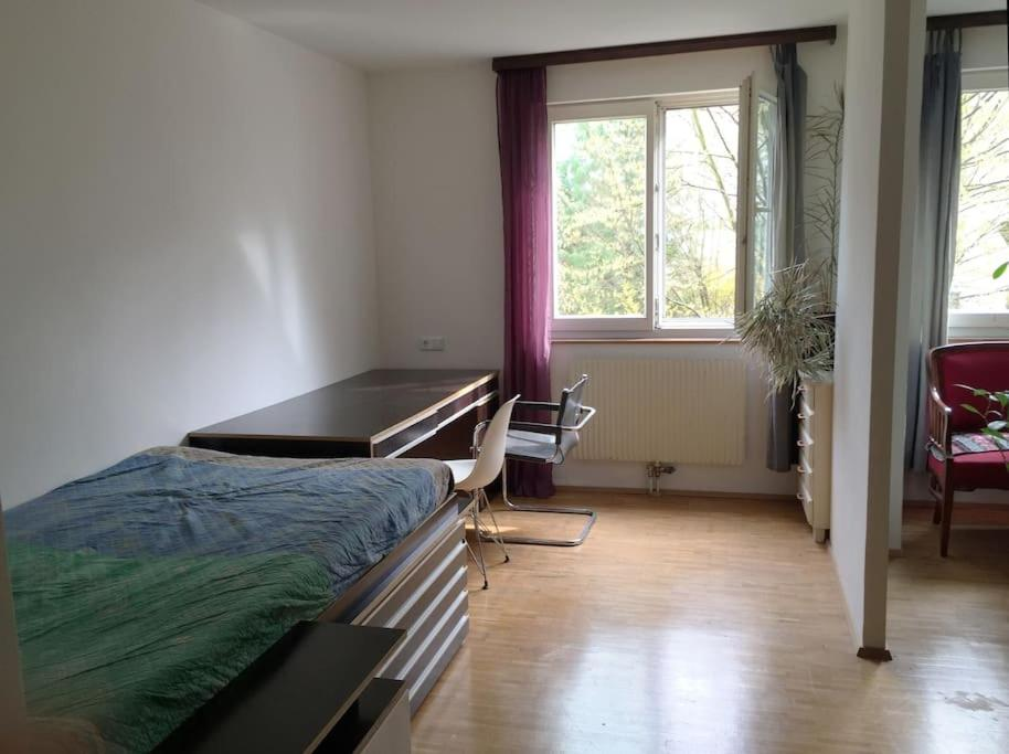 A bed or beds in a room at Room in maisonette with garden, parking place